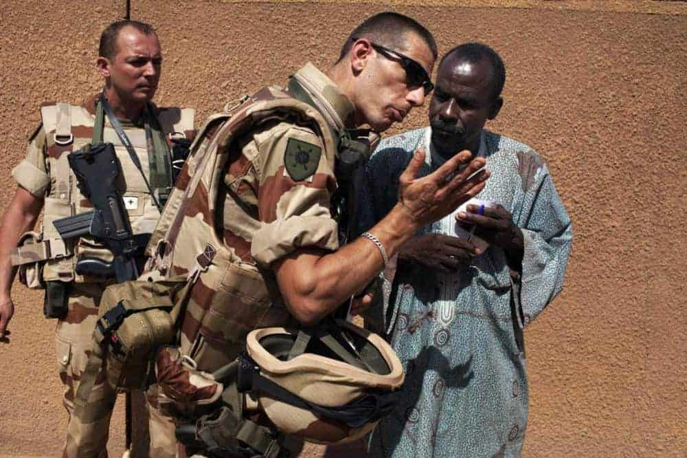 A French soldier talks with a civil society leader in Gao