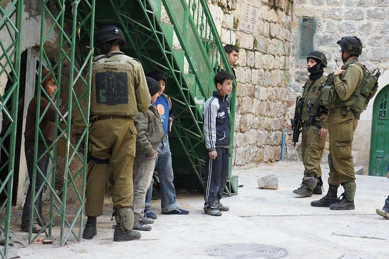 Israeli soldiers and Palestinian children, West Bank