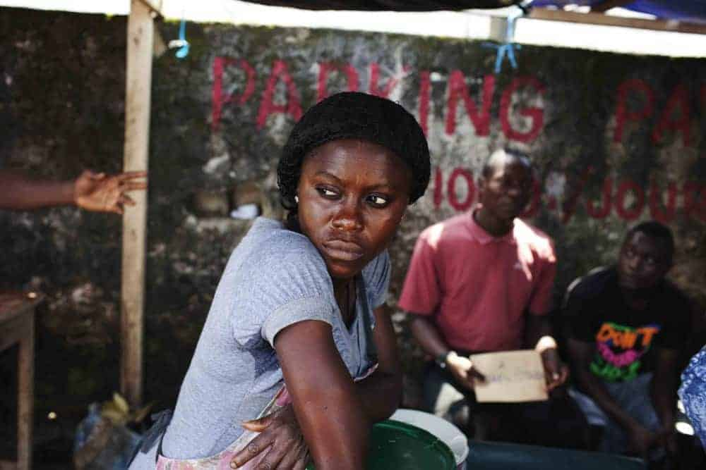Woman at food stall in Douala, Cameroon.