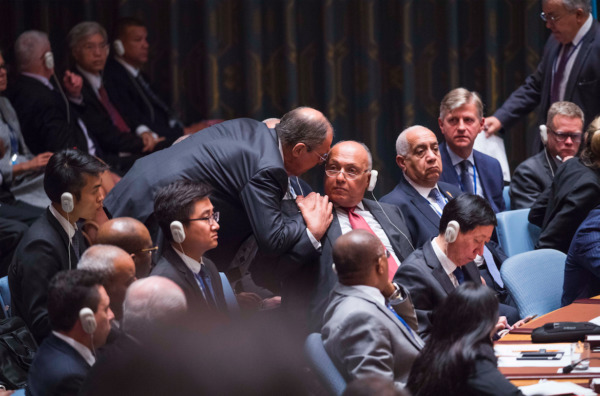 Sergey Lavrov, Russia's foreign minister, whispering to Egypt's for AMANDA VOISARD/UN PHOTO