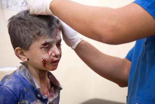 A child amid the attacks in eastern Aleppo