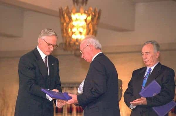 Prime Minister Yitzhak Rabin of Israel receives the Nobel Peace as his foreign minister, Shimon Peres, applauds. CREATIVE COMMONS