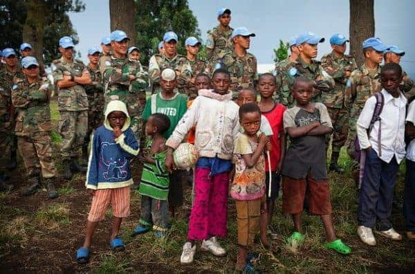Peacekeepers from Uruguay helping to launch a soccer school in Goma, the Democratic Republic of the Congo, in 2014. SYLVAN LEICHTI/UN PHOTO