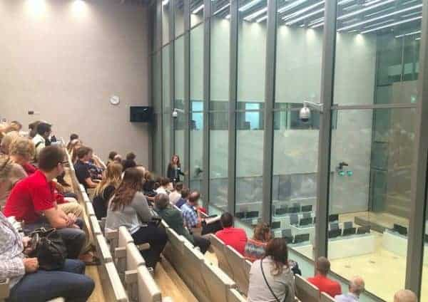 Visitors to the ICC on Sept. 25, 2016, in a public gallery overlooking a courtroom. ICC-CPI