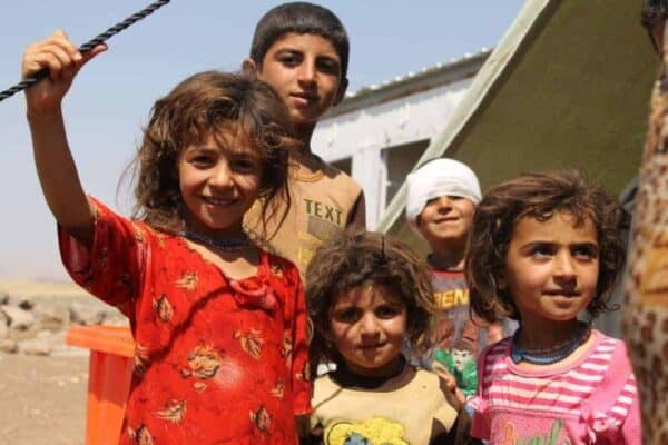 Yezidi refugees from Iraq arriving in northeastern Syria, having escaped ISIS. They walked RACHEL UNKOVIC/INTERNATIONAL RESCUE COMMITTEE/CREATIVE COMMONS
