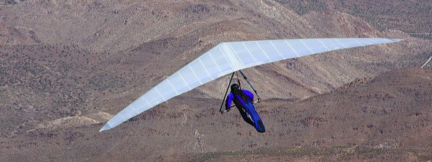 A male hang glider, above, takes off from a cliff in eastern San Diego County, California