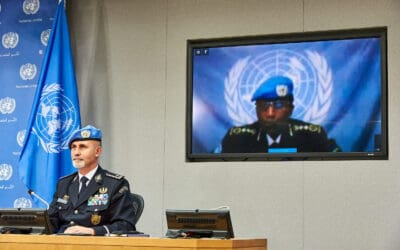 UN Police Luis Carrilho at desk and Mary Gahonzire on video