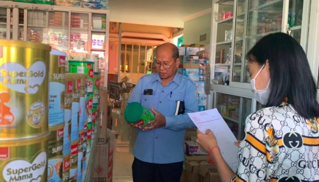 Photo of In Cambodian officials checking enforcement of WHO's International Code of Marketing Breast-Milk Substitutes,